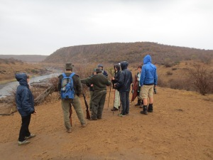 Last minute instructions from Aron, overlooking the Oliphant's river. The confluence is around the corner at the bask of the mountain on the right.